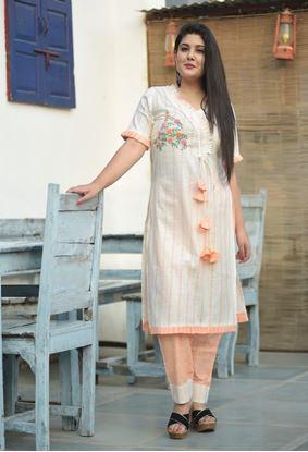 Picture of s.k mani #cream beautiful elegant strght kurta with orange paizma