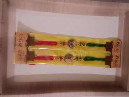 Picture of Set of 2 Rakhi for brother with 1 Roli tika