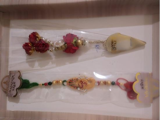 Picture of Rakhi for brother and  lumba for bhabhi with 1 Tika roli